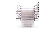 This is a stack of 7 Plastic Feeder Trays measuring approximately 9.75 inches